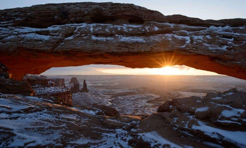 Mesa Arch at Canyonlands in the winter with snow