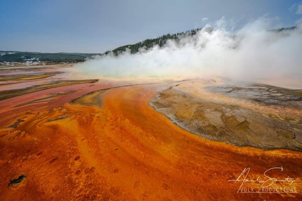 using a high horizon line to focus on the colorful Grand Prismatic at Yellowstone
