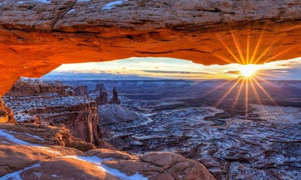 Mesa Arch at sunrise with snow