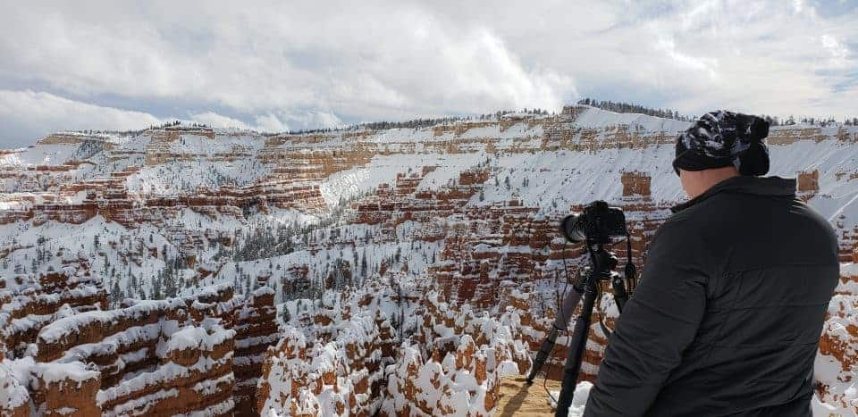 photographer at Bryce Canyon National Park with snow