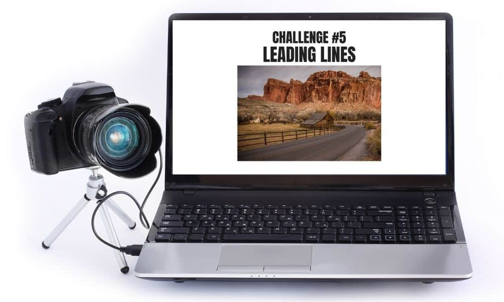 camera and laptop with photography challenge displayed