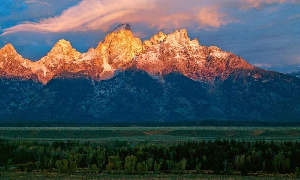 light on grand teton mountains