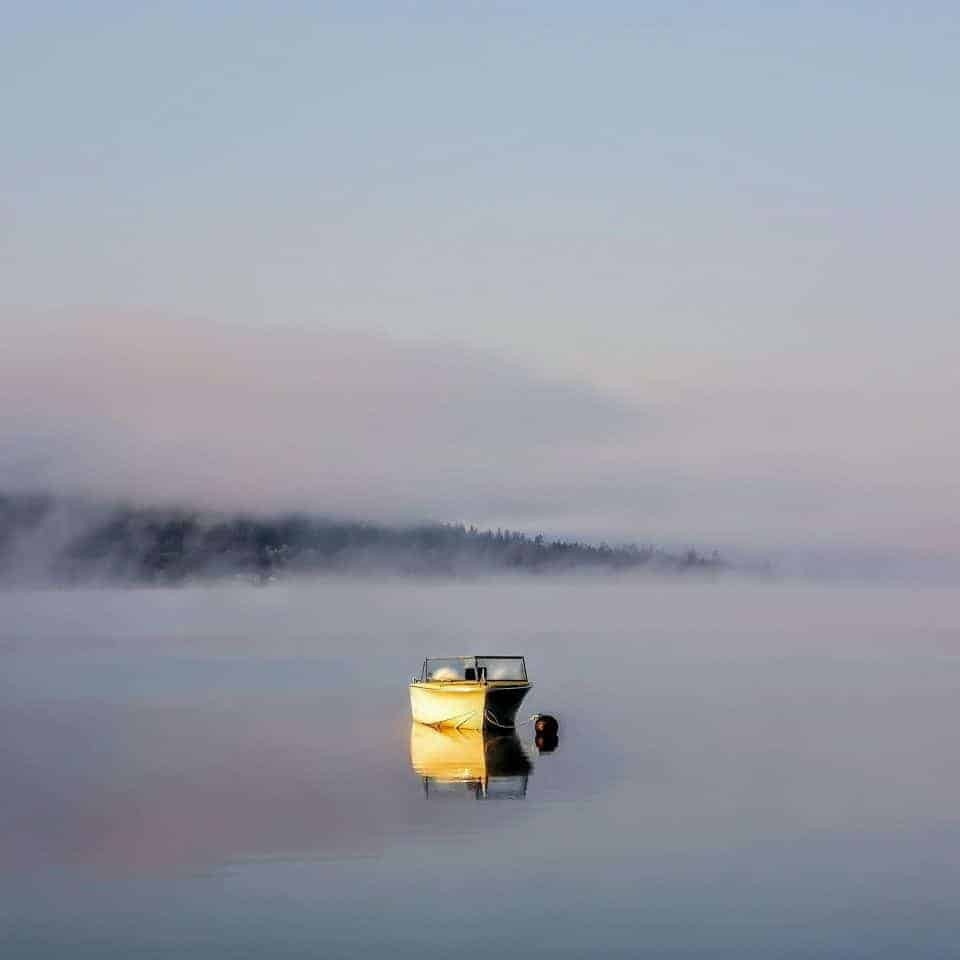 boat on a lake by Dani McCulloch